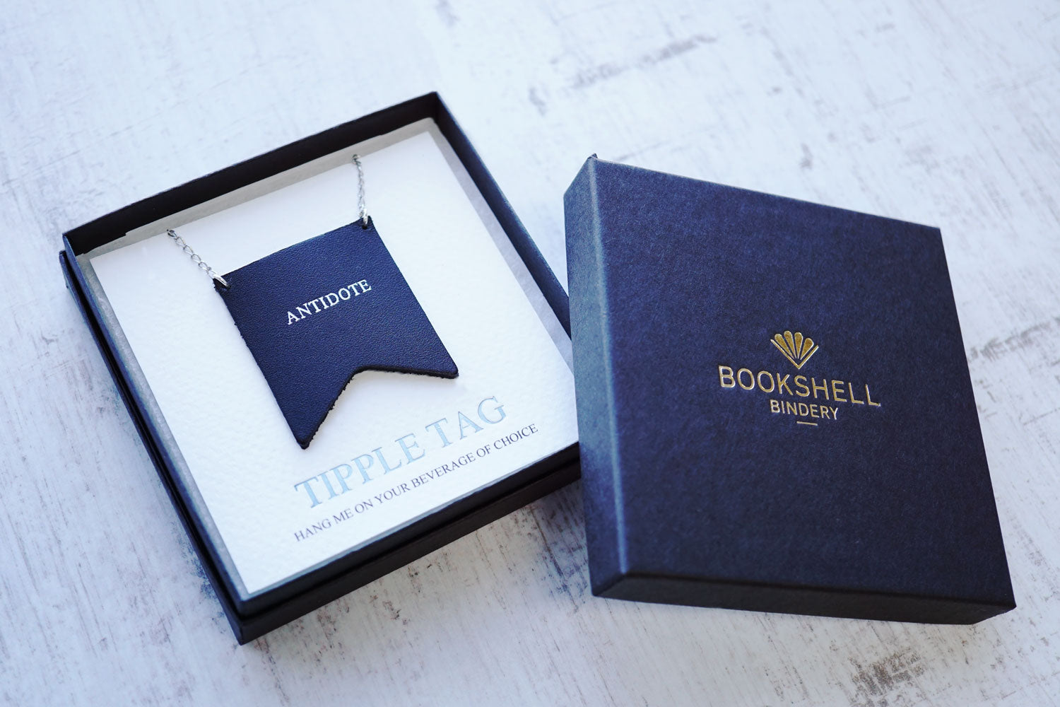 Custom decanter tags from Bookshell Bindery are ready to gift in a beautiful gift box