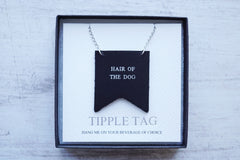 Custom decanter tags with the phrase Hair of the dog