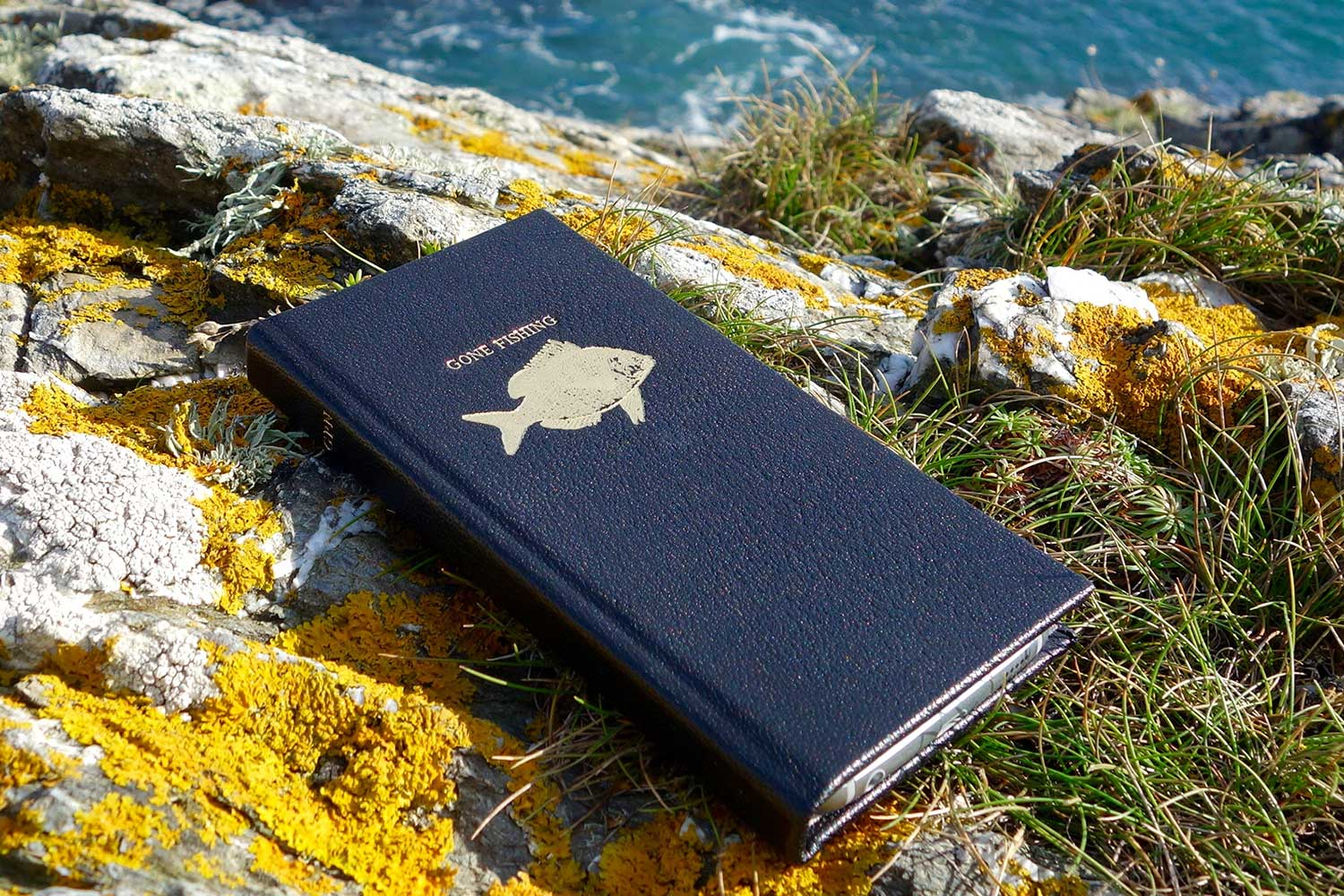 custom leather phone cases from Bookshell in black leather with fish picture