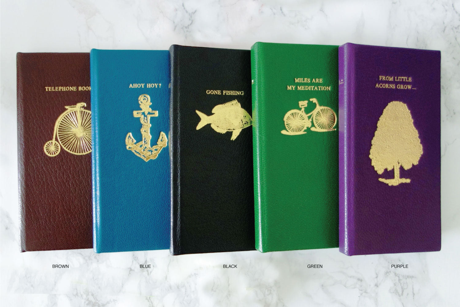 Custom leather phone cases from Bookshell in brown leather, blue leather, black leather, green leather, purple leather