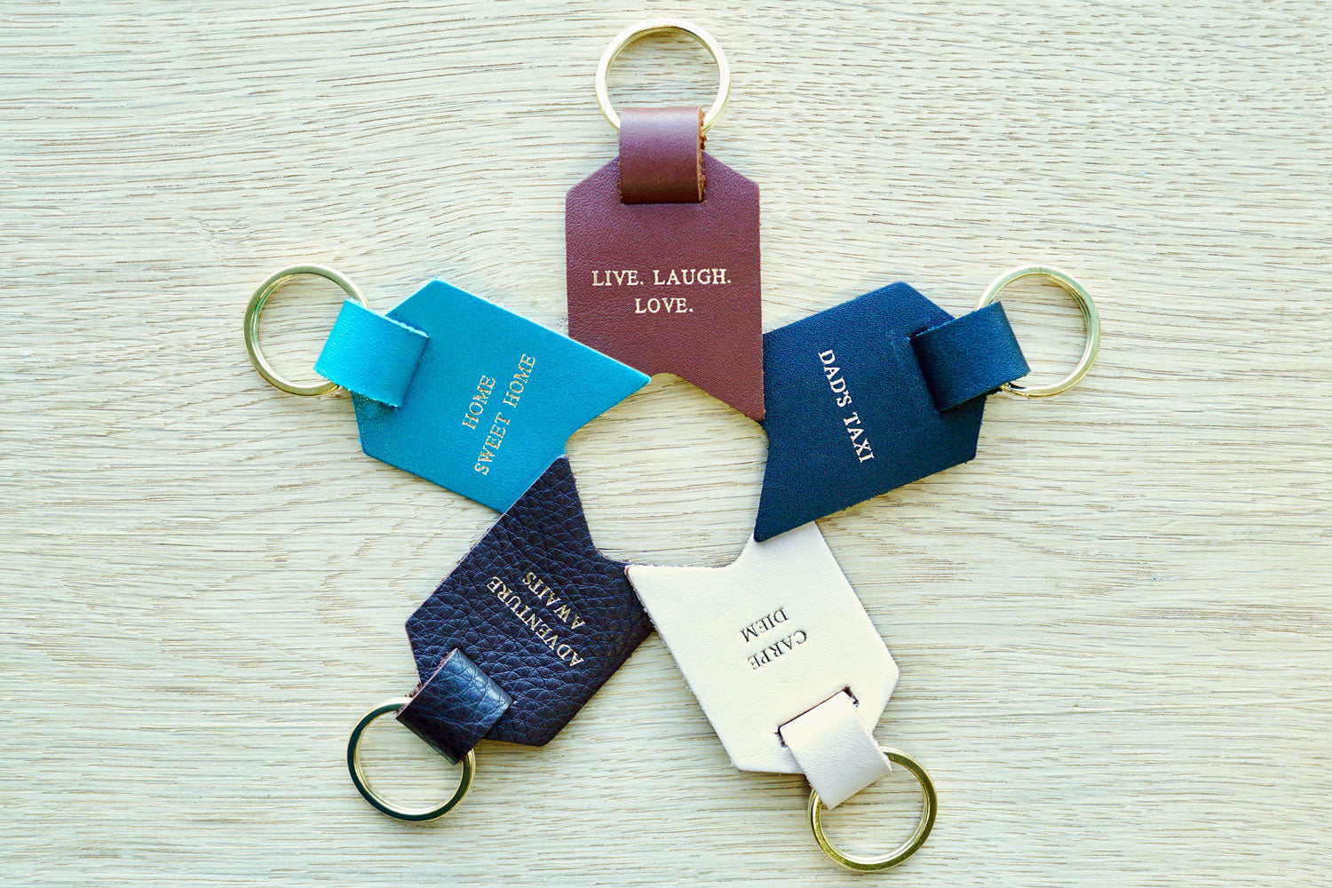 Personalised Keyrings for Dad from Bookshell Bindery, available in Black, Dark Brown, Light Brown, Turquoise blue and Cream