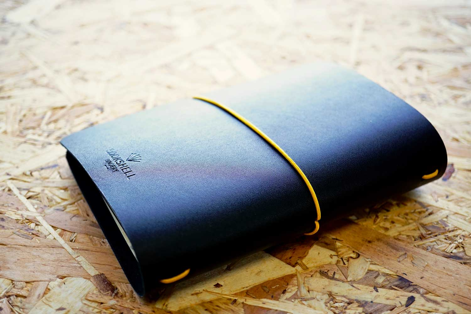 Never-ending journal, Explore. Dream. Discover; A6 leather travel journal with gold foiled compass on the cover, show the back cover