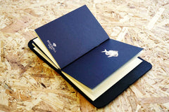 Never-ending journal - Seas the day, leather travel journal, with 3 A6 pocket size inner notebooks, this photo shows the fish illustration embossed in gold foil onto the cover