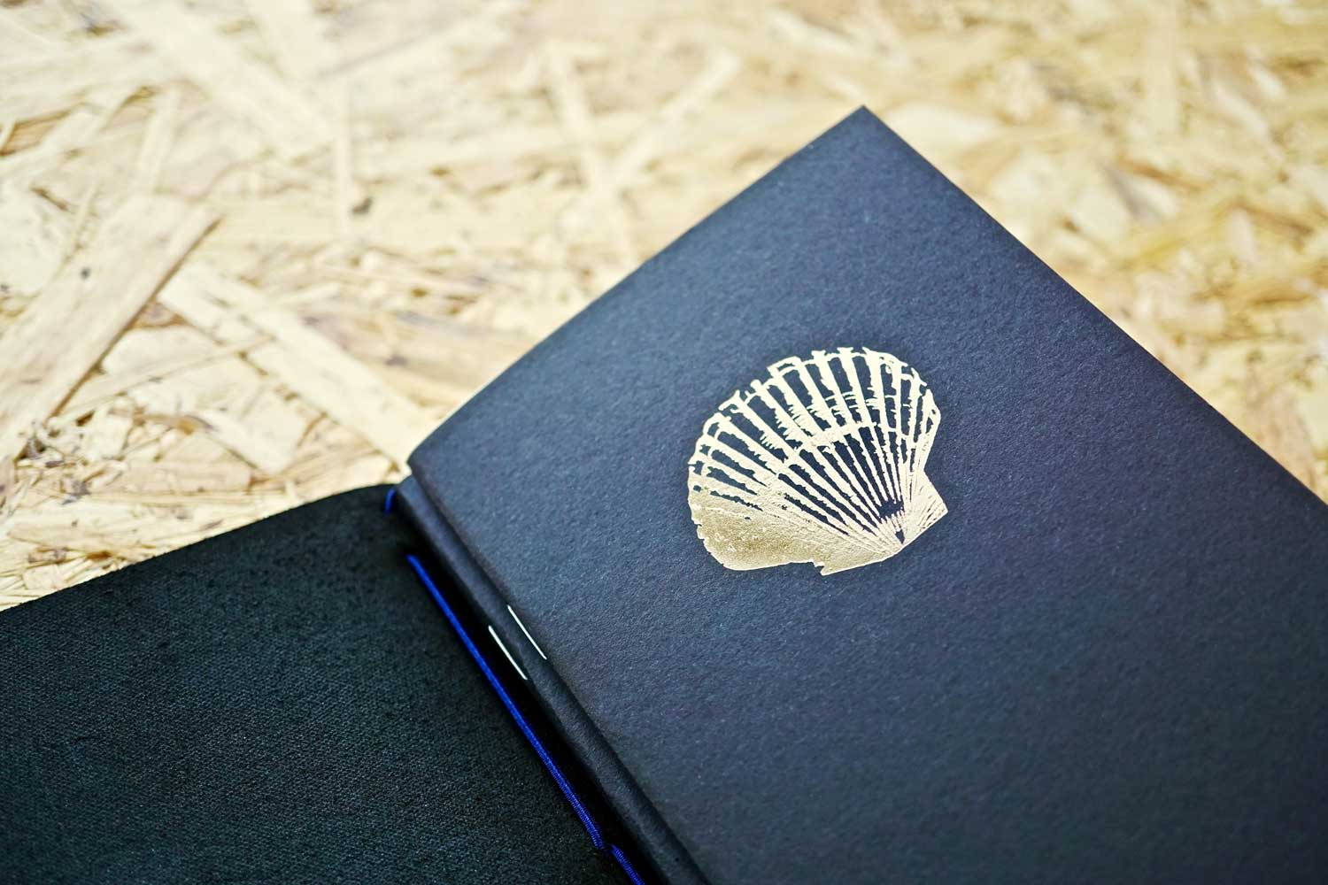 Never-ending journal - Seas the day, leather travel journal, with 3 A6 pocket size inner notebooks, this photo shows the shell illustration embossed in gold foil onto the cover