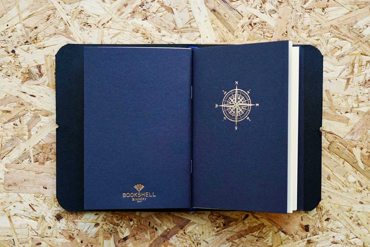 Never-ending journal - Seas the day, leather travel journal, with 3 A6 pocket size inner notebooks, this photo shows the compass illustration embossed in gold foil onto the cover