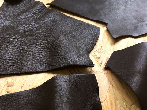 Showing the texture of the Scrap Leather Offcuts – Dark Brown Cowhide Leather Pieces