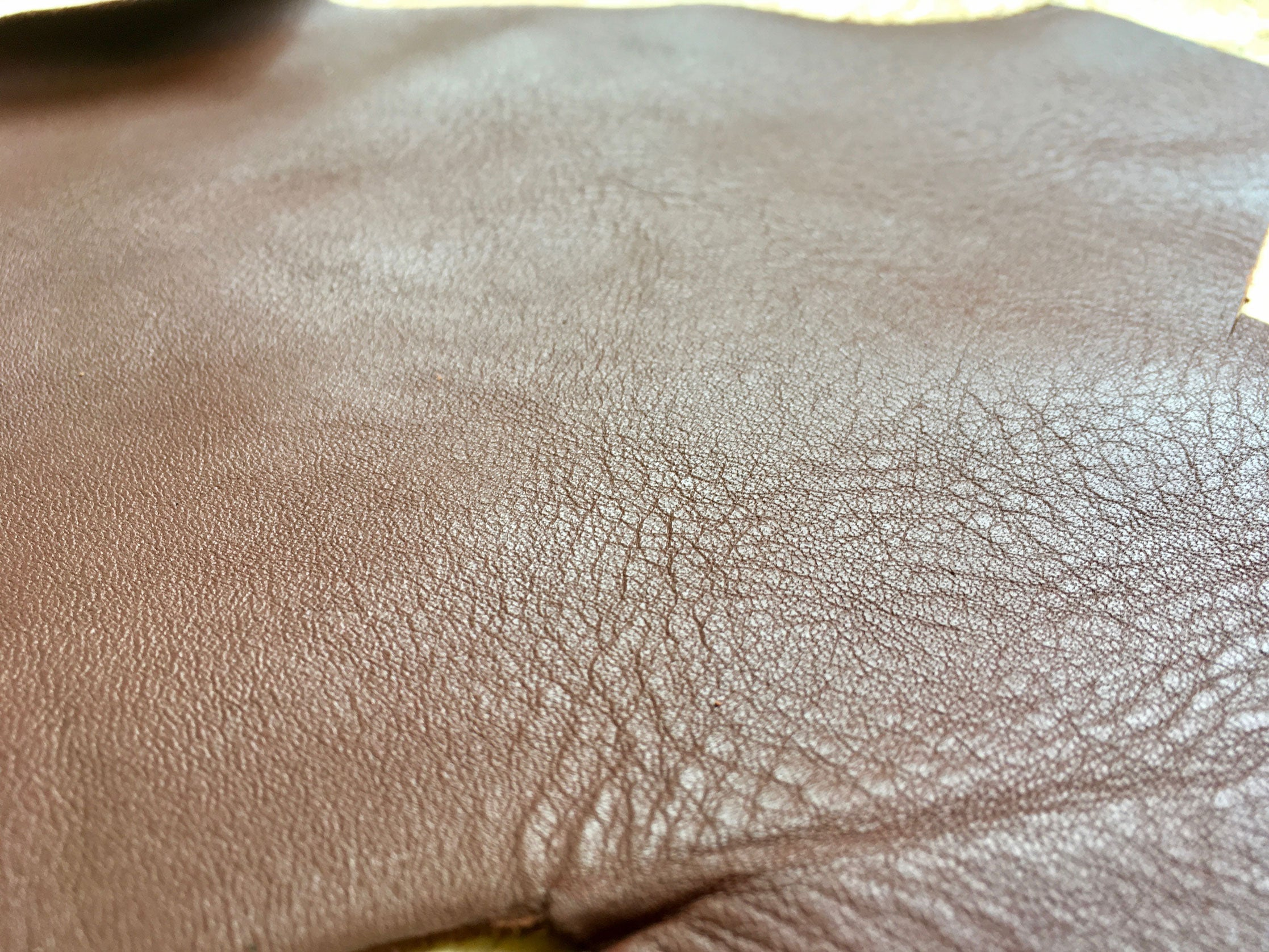 Texture of Scrap Leather Offcuts – Light Brown Cowhide Leather Pieces by Bookshell Bindery