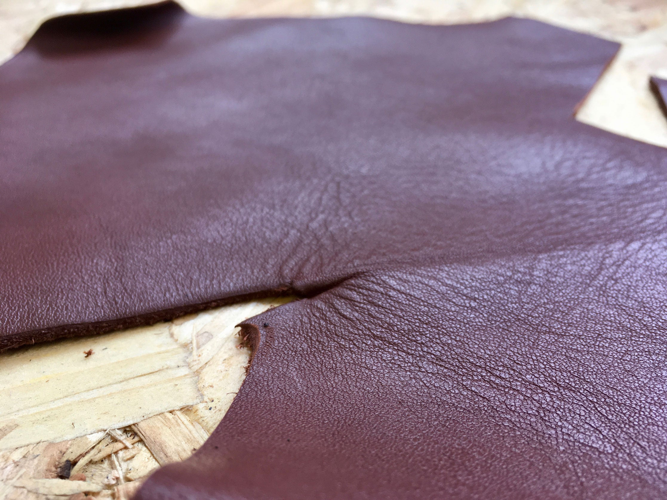 Close-up of texture of Scrap Leather Offcuts – Light Brown Cowhide Leather Pieces by Bookshell Bindery