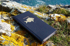Leather iphone case from Bookshell in black with fish cover picture embossed in gold foil and title Gone fishing