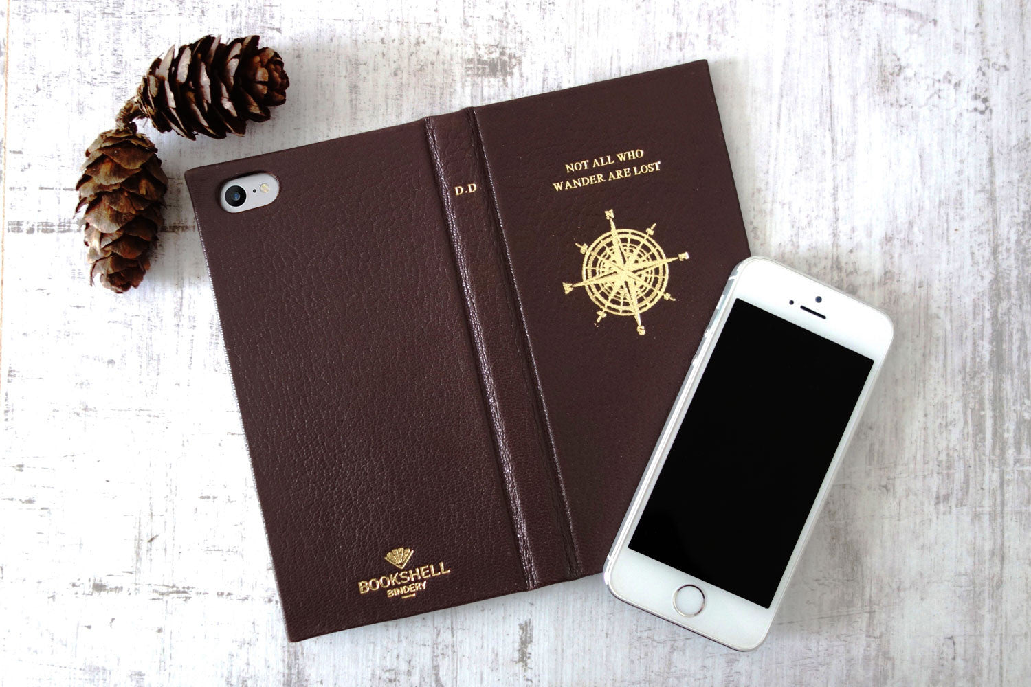 Leather iphone case from Bookshell in brown with compass cover picture embossed in gold foil