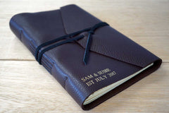 Leather journal in dark brown can be used as a rustic guestbook for a wedding