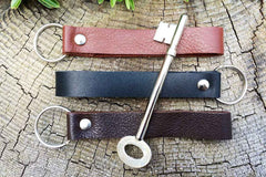 Leather key chain from Bookshell available in light brown, dark brown and black leather