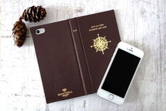 Luxury leather phone cases in brown leather with a compass on the cover from Bookshell