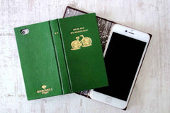 Luxury leather phone cases in green leather with a bicycle on the cover from Bookshell