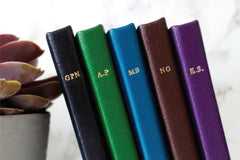 Luxury leather phone cases bespoke spine monogramming from Bookshell