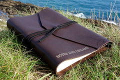 Men's journal from Bookshell bindery with Hopes and Fears on the cover