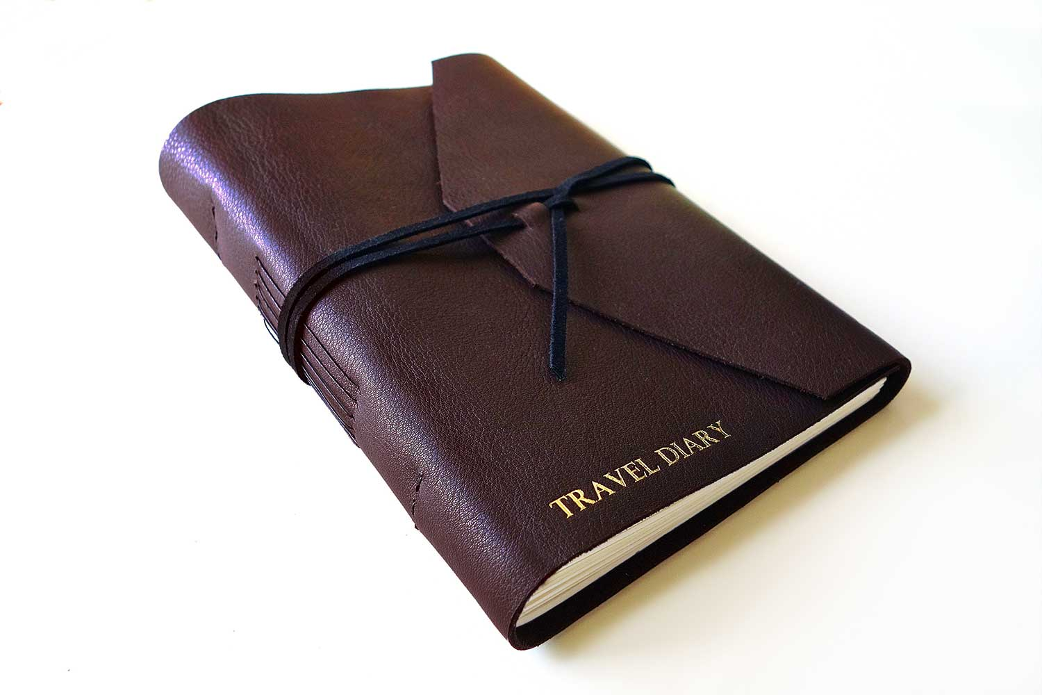 Men's journal from Bookshell bindery with Travel Diary on the cover
