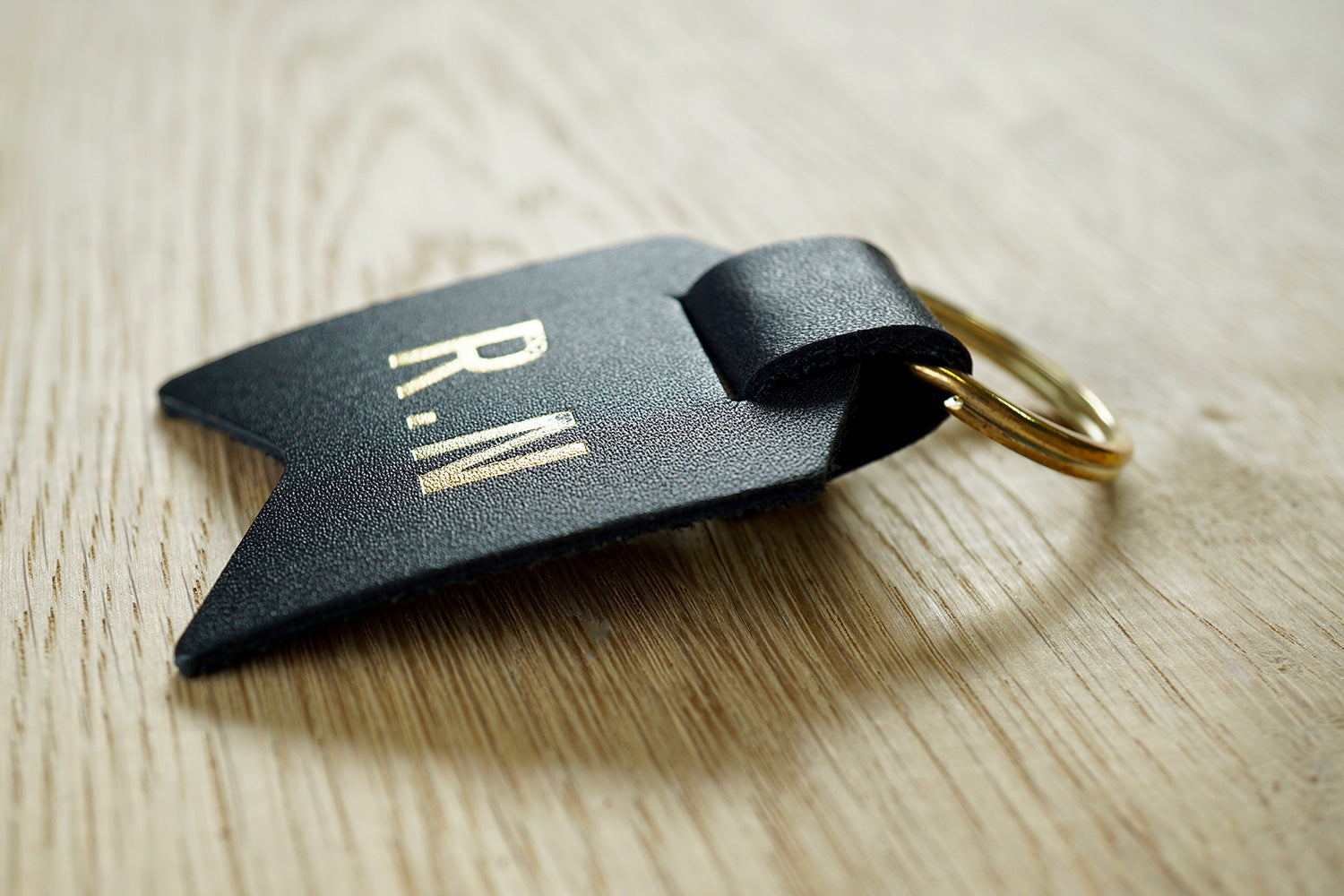 Monogram keychain from Bookshell bindery can monogrammed with 1 or 2 initials
