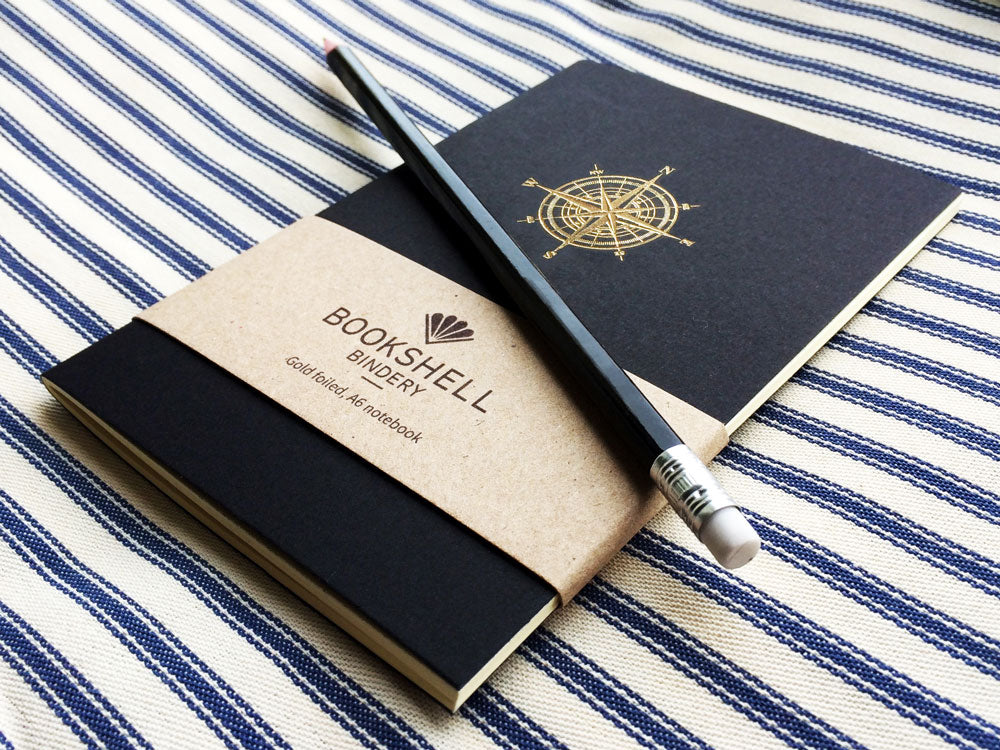 Pocket notebook with choice of gold foil picture from Bookshell, compass