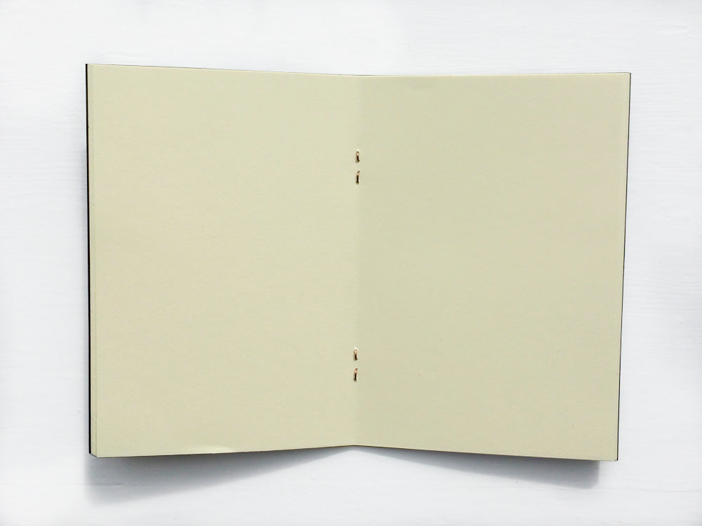 Pocket notebook with blank pages from Bookshell Bindery
