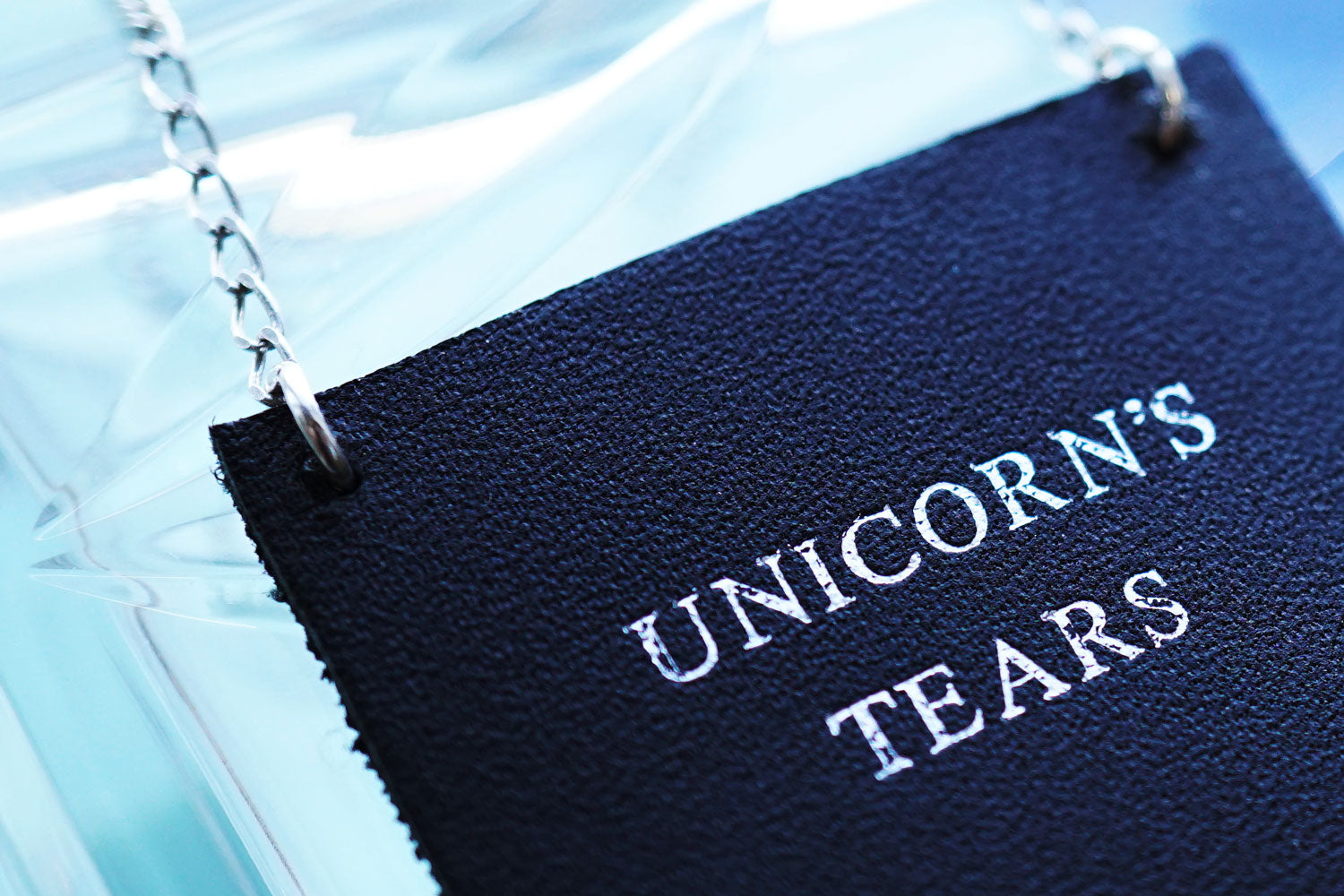 personalised leather bottle label with the words Unicorn's tears