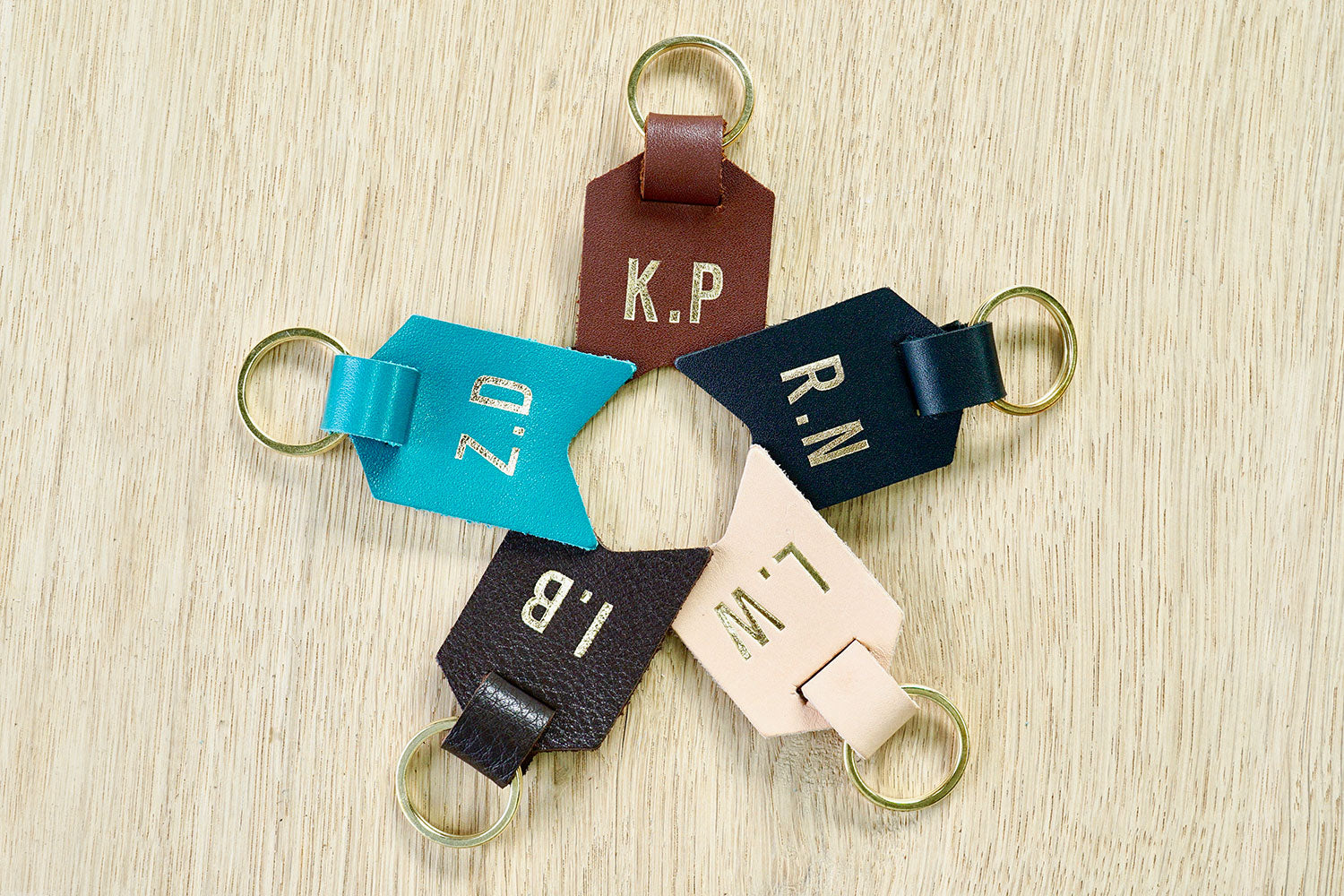 Personalised Daddy keyring from Bookshell bindery available in black leather, turquoise blue leather, dark brown leather, light brown leather, Natural (pale pink)