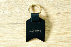 Personalised Daddy keyring from Bookshell Bindery with Man cave embossed with gold foil