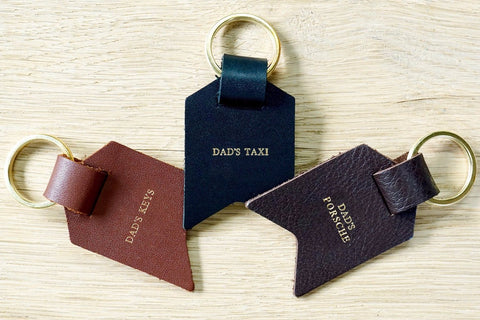 Personalised Daddy keyring from Bookshell Bindery with Dad's keys, Dad's taxi and Dad's Porsche embossed with gold foil