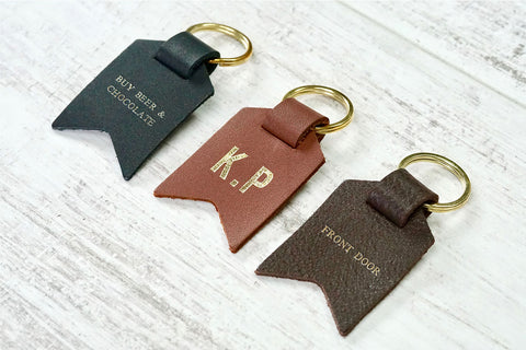 Personalised Daddy keyring from Bookshell Bindery with Buy beer and chocolate, monogram, front door, embossed with gold foil