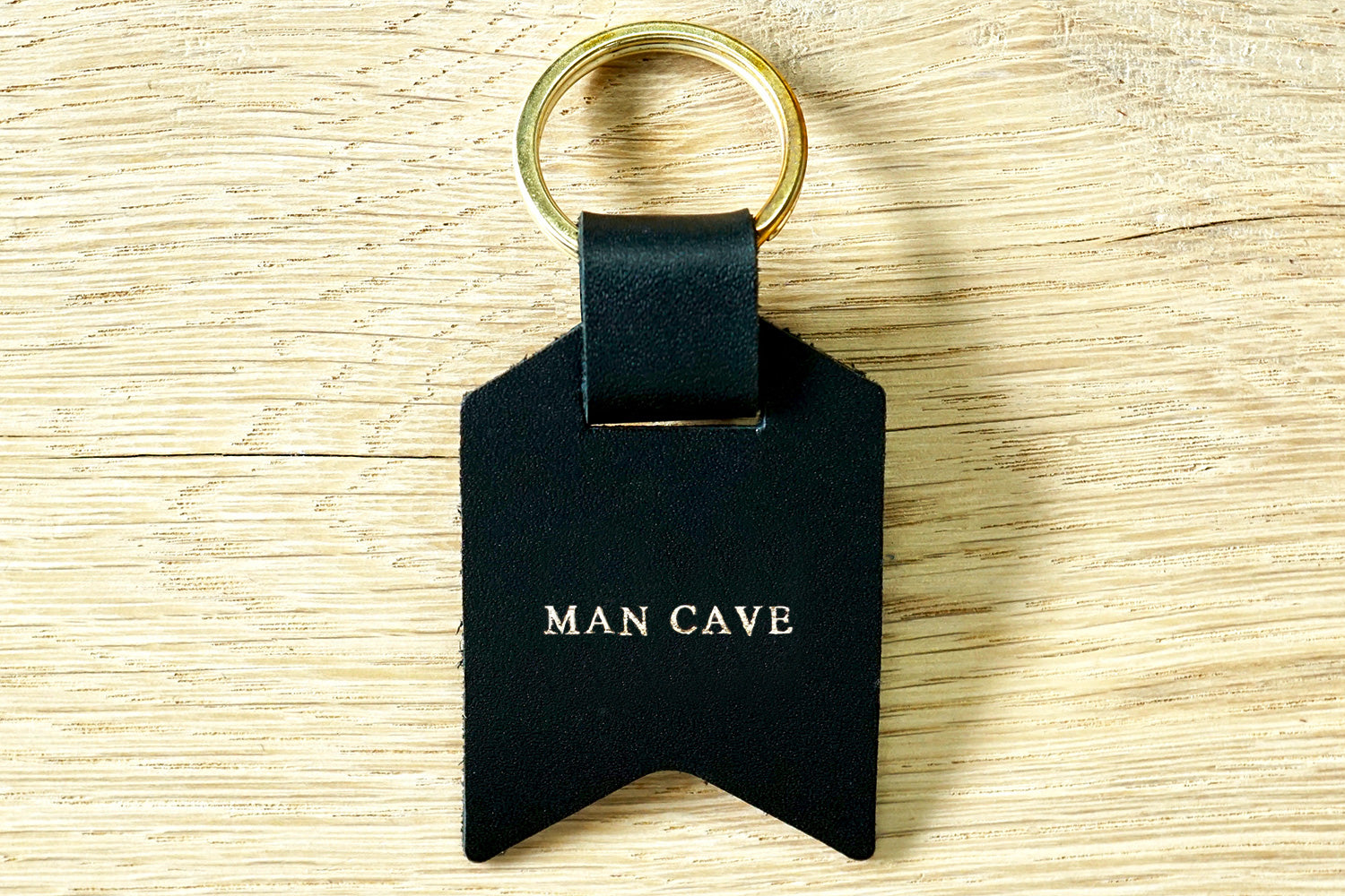 Peronalised keyrings from Bookshell Bindery in black leather with 'Man cave'