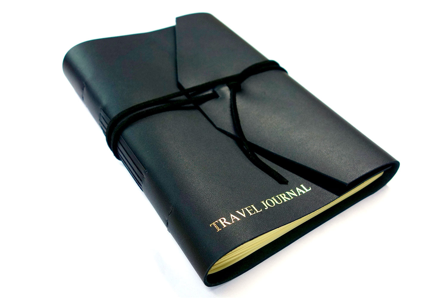 Personalized leather journal in black leather from Bookshell bindery with Travel Journal embossed in gold on the cover