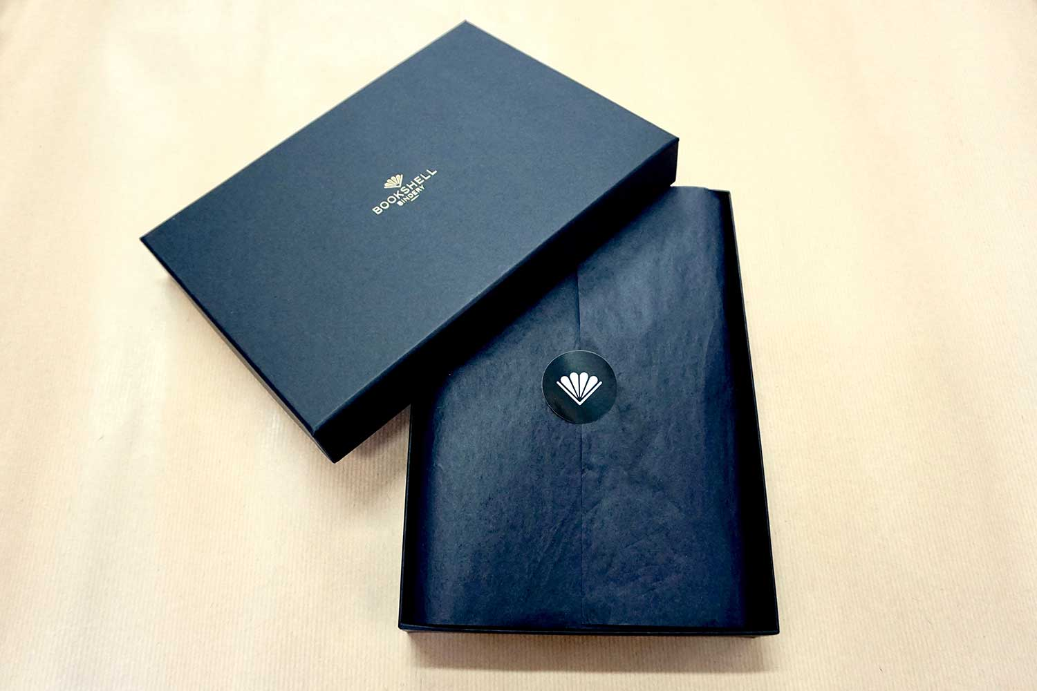 Personalized leather journal in dark from Bookshell bindery is ready to gift in beautiful packaging