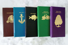 book phone case in brown, blue, black, green and purple leather from Bookshell Bindery