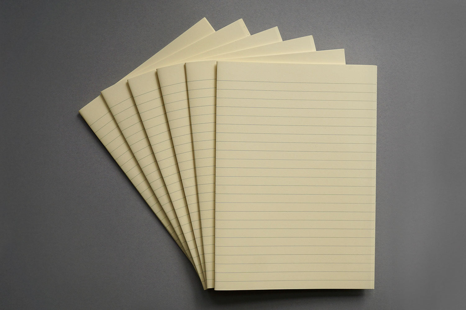Bookbinding paper from Bookshell bindery, cream with lined pages
