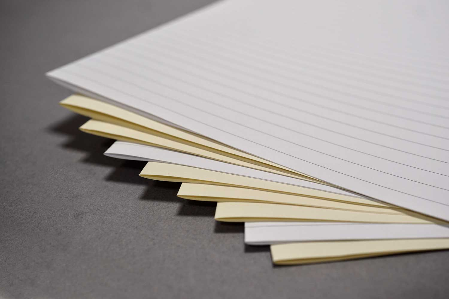 Bookbinding paper from Bookshell bindery, cream with lined pages and short grain