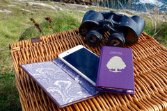 iphone leather book case from Bookshell Bindery in purple leather with tree and binoculars