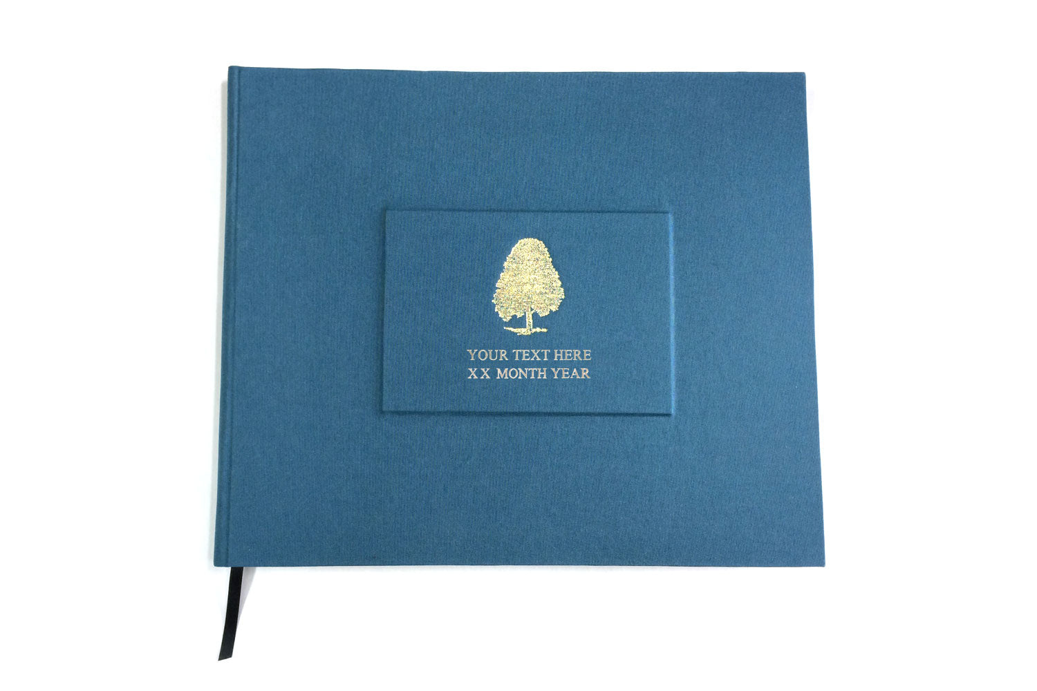 Blue personalised wedding guest book from Bookshell bindery, hand bound in blue book cloth with gold foil embossing, tree cover picture