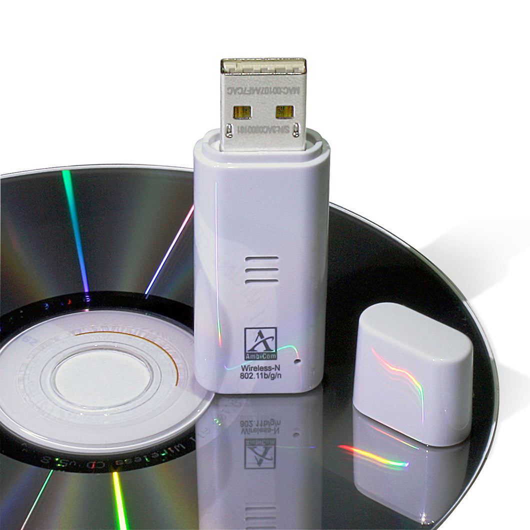 USB Wireless N Network Adapter sitting on CD - Monarch Instrument