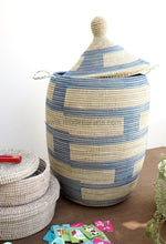 Decluttering kids room with beautiful graphic laundry baskets. Graphic patterned storage basket will be helpful.