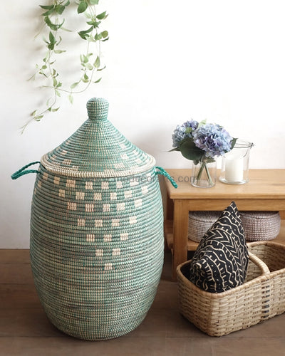 African basket with graphic pattern made of seagrass. It can hold many clothing and can help to declutter your home.