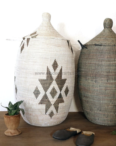 African basket with graphic pattern made of seagrass. This hamper holds many clothing and can help to declutter your home.