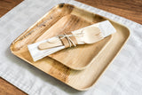 Birch wood cutlery kit on palm leaf plates