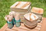 Collection of birch wood utensils and palm leaf dishes