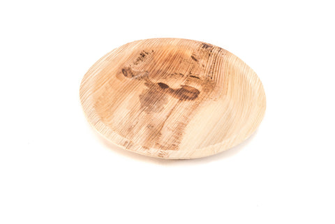 6 inch round palm leaf plate at angle