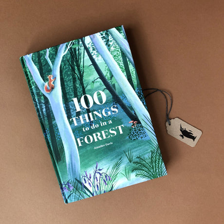 100-things-to-do-ina-forest-front-cover-woth-tree-and-squirrel-illustration