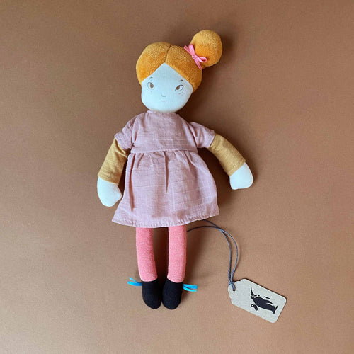 agathe-doll-with-orange-hair-pink-dress-with-yellow-long-sleeve-layer