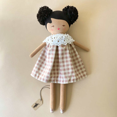 aggie-doll-with-tan-skin-rose-check-dress-and-lace-collar-and-black-pom-pom-hair