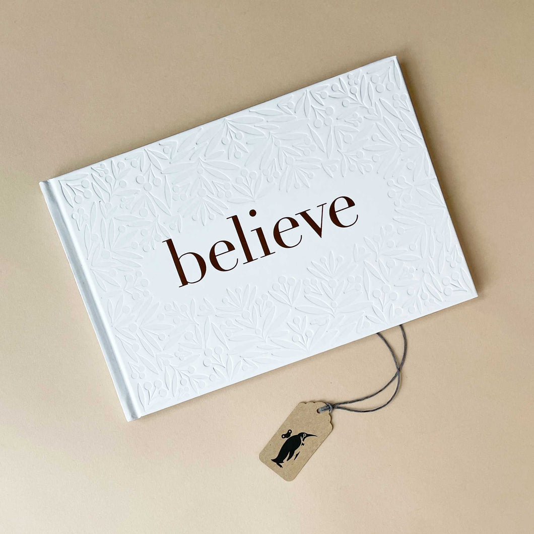 believe-book-white-cover-with-gold-lettering-and-imprinted-floral-design