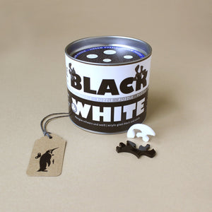 black-and-white-puzzle-in-round-tin-with-irregularly-shpaed-pieces