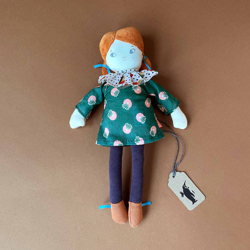 blanche-doll-with-green-dress-with-pink-floral-bud-accents-and-a-polka-dot-ruffled-collar-blue-jeans-brown-shoes-and-auburn-hair